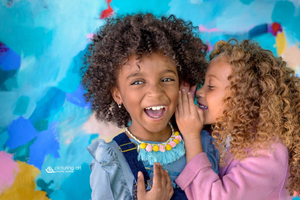 lifestyle, girls, giggle, laugh, secret, whisper, African American, natural hair, curly hair, curly, colorful, kids, portraits, photography, pictures, photo, photo session, family session, picturing art, donna dunlap
