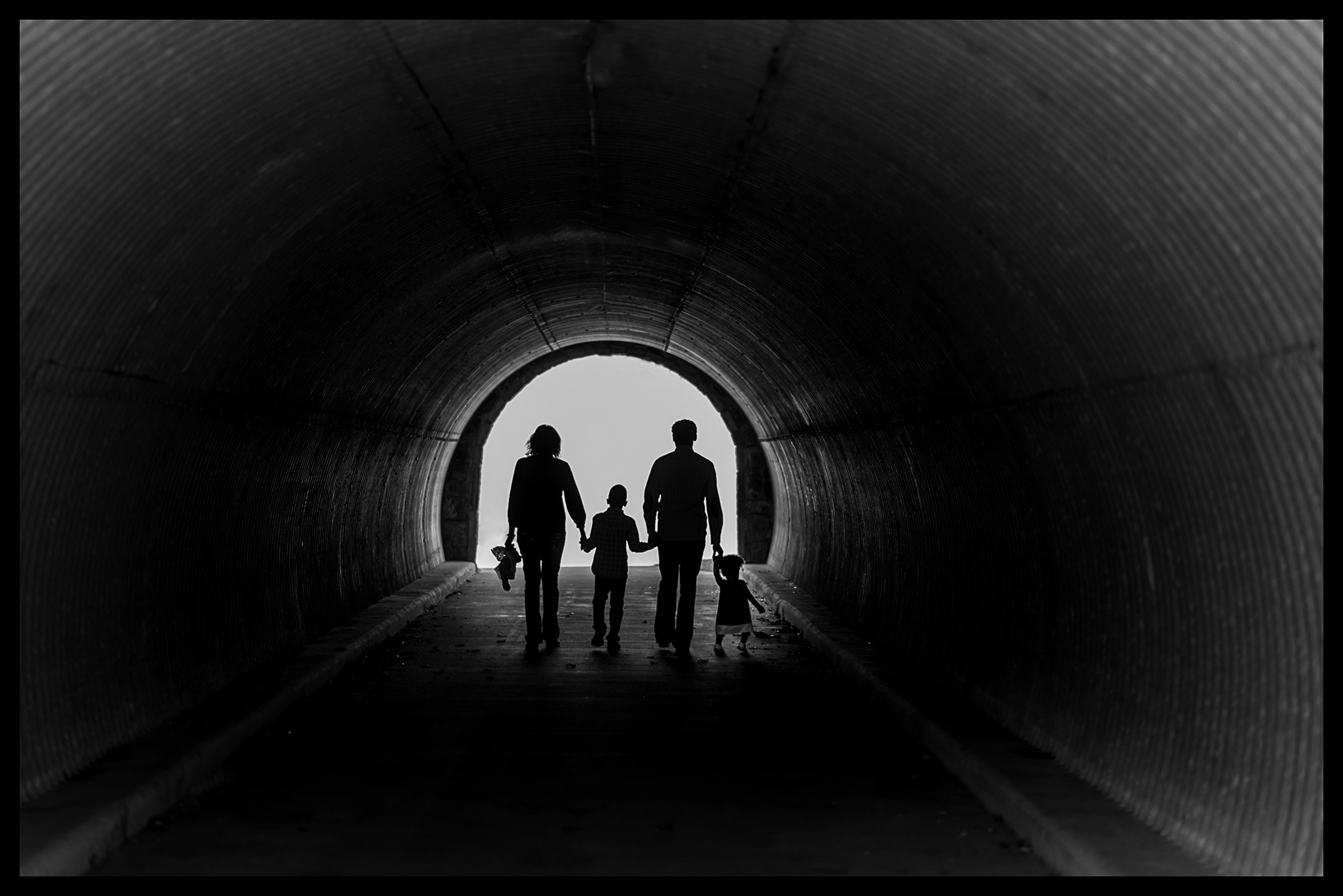 silhouette, tunnel, black and white, family, family pictures, family portraits, family photo session, picturing art, donna dunlap, cinematography, video, fusion